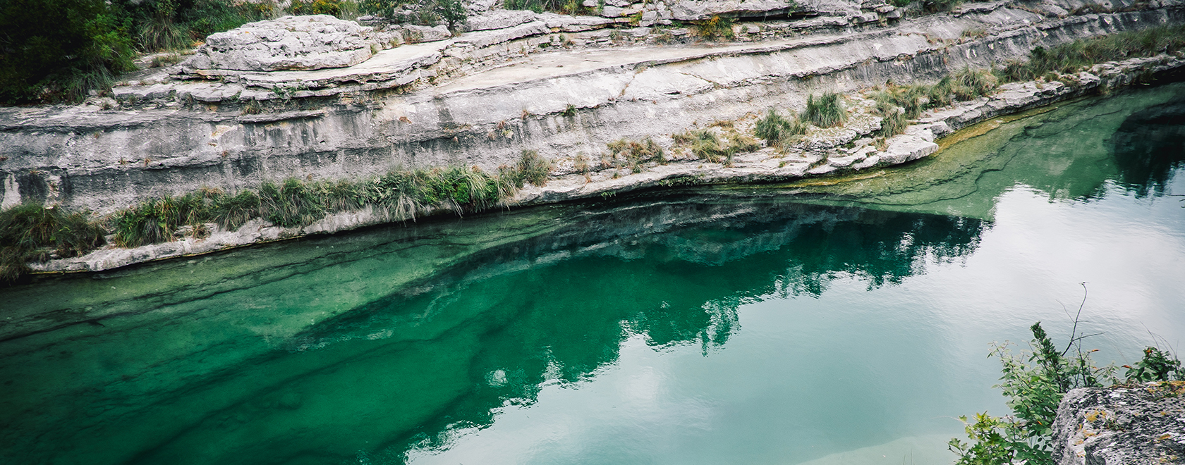Photo of a lush canyon body of water